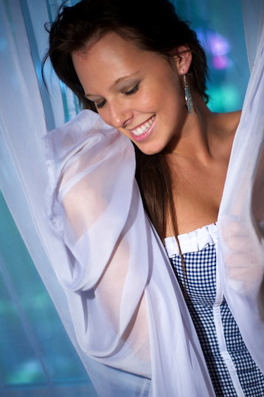 Dallas - Boudoir image of smiling girl in corset